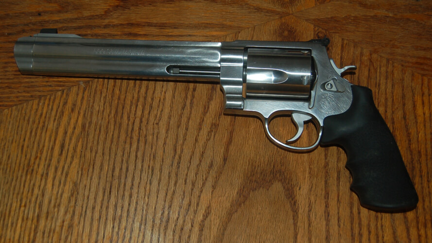 smith wesson 500 revolver on wood table